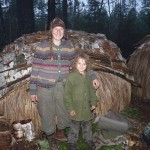 me and my son in front of a summer lodge